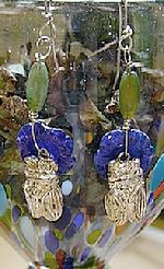 "*ONE OF A KIND* These unique CICADA earrings  have a tiny 1/2""STERLING SILVER  CICADA on a carved Lapis flower. They are suspended by sterling silver wires from a green Agate rice bead. They are just over 2"" long. Price: $75.00"
