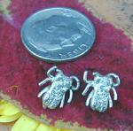 Tiny unique Fly Ear Studs.Sterling Silver. (Picture is very much enlarged! ) $65.00/pr.